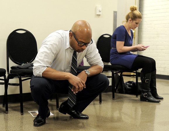 "Cajardo Lindsey, left, and Devon James, both of Denver, wait for their names to be called during an audition for the Colorado Shakespeare Festival on Friday, Jan. 18, at the Denver Performing Arts Tramway building in Denver. For more photos and video of the audition go to  <a href=""http://www.dailycamera.com"">http://www.dailycamera.com</a> Jeremy Papasso/ Camera"