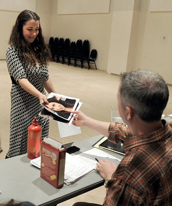 Lanie Novack, of Longmont, gives her head shots to Tim Orr before the start of her audition for the Colorado Shakespeare Festival on Friday, Jan. 18, at the Denver Performing Arts Tramway building in Denver. For more photos and video of the audition go to www.dailycamera.com Jeremy Papasso/ Camera