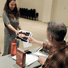 "Lanie Novack, of Longmont, gives her head shots to Tim Orr before the start of her audition for the Colorado Shakespeare Festival on Friday, Jan. 18, at the Denver Performing Arts Tramway building in Denver. For more photos and video of the audition go to  <a href=""http://www.dailycamera.com"">http://www.dailycamera.com</a> Jeremy Papasso/ Camera"
