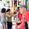 BEN GARVER — THE BERKSHIRE EAGLE<br /> Ashley Pryall shoots a cork gun at  the Columbia County Fair, Labor Day in Chatham, New York with her daughters Violet, 3, and Nevaeh, 13 watching, Monday September 3, 2018. (Ben Garver / The Berkshire Eagle Via AP)