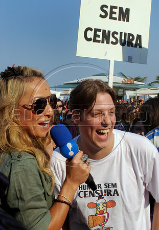 "Comedians Sabrina Sato, left, and Fabio Porchat participate at a  protest against a law that prohibits making fun of presidential candidates  on Copacabana beach Rio de Janeiro, Brazil, Aug. 22, 2010. In the banner say: ""Without censure"". Brazilian TV and radio broadcasters are legally forbidden from making fun of candidates ahead of the nation's Oct. 3 election and a possible second-round runoff on Oct. 31. (Austral Foto/Renzo Gostoli)"