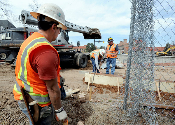 "Manual Uribe, left, of Concrete Works, helps with measurement   at the construction site at Broadway and Euclid across  from the UMC on the CU campus.<br /> For a video and photos of the construction, go to  <a href=""http://www.dailycamera.com"">http://www.dailycamera.com</a>.<br /> Cliff Grassmick / April 5, 2012"