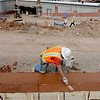 "Manual Uribe of Concrete Works works on the wall of a  pedestrian ramp at the construction site at Broadway and Euclid across from the UMC on The CU campus.<br /> For a video and photos of the construction, go to  <a href=""http://www.dailycamera.com"">http://www.dailycamera.com</a>.<br /> Cliff Grassmick / April 5, 2012"