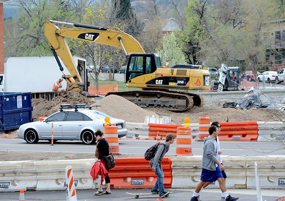 CU students walk along Broadway near Euclid. For a video and photos of the construction, go to www.dailycamera.com. Cliff Grassmick / April 5, 2012