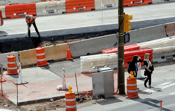 "CU students cross Broadway at Euclid at the underpass construction site.<br /> For a video and photos of the construction, go to  <a href=""http://www.dailycamera.com"">http://www.dailycamera.com</a>.<br /> Cliff Grassmick / April 5, 2012"