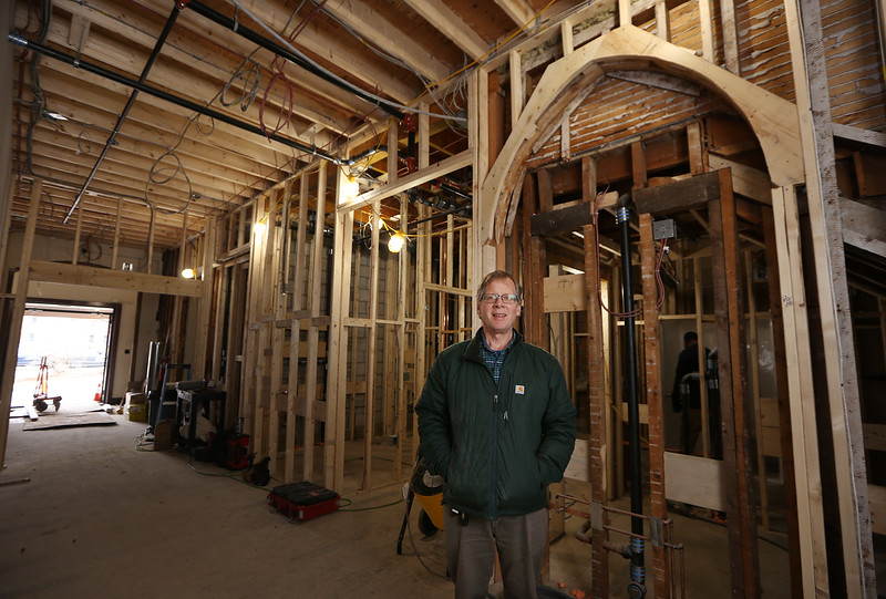 Christ Church United construction project continues.  Rev. Peter Lovett, in front of a portion of Fellowship Hall which is being converted to bathrooms. The arch at right won't be a doorway but will be preserved as an architectural feature. (SUN/Julia Malakie)