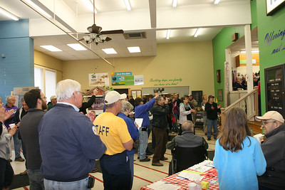 HALEE HEIRONIMUS / GAZETTE People gathered in the ReStore lobby to celebrate the 25th anniversary of Medina County's Habitat for Humanity.