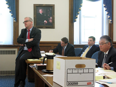 ELIZABETH DOBBINS / GAZETTE   Defense attorney Michael O'Shea questions a witness in the trial of Eric Warfel Tuesday. Fellow defense attorney Mark Ondrejech and Warfel sit behind O'Shea and Prosecuting Attorney Dean Holman sits on the far right.
