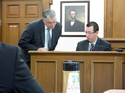 ELIZABETH DOBBINS / GAZETTE   Medina County Prosecutor Dean Holman and Det. Josh Grusendorf look at cell phone records during the trial of Eric Warfel Tuesday.