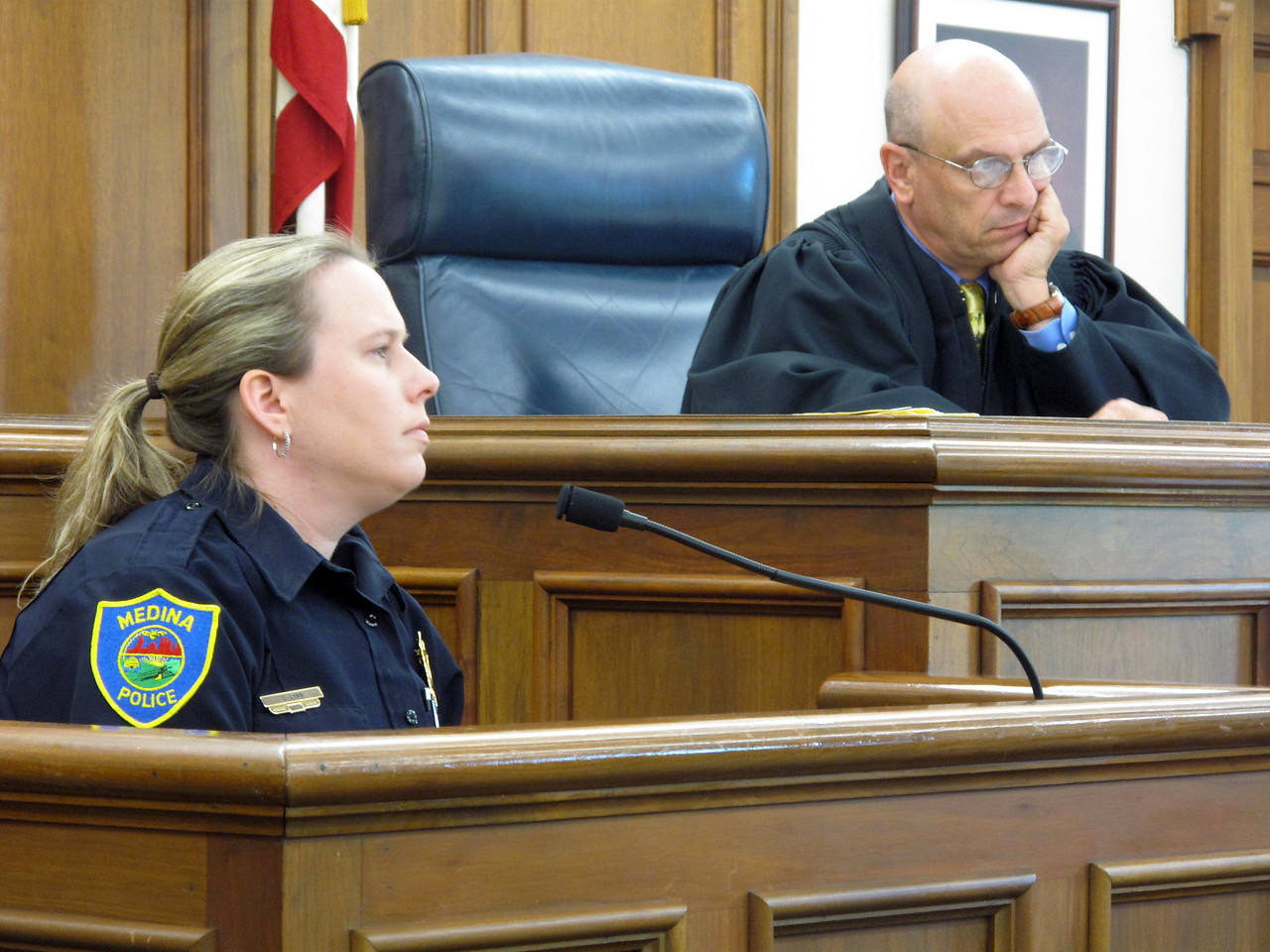 ELIZABETH DOBBINS / GAZETTE  Medina Police Detective Sarah Lynn testifies in Medina County Common Judge Christopher J. Collier's court.