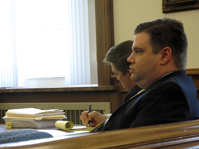 ELIZABETH DOBBINS / GAZETTE  Eric Warfel sits next to his lawyer Michael O'Shea in court Tuesday.