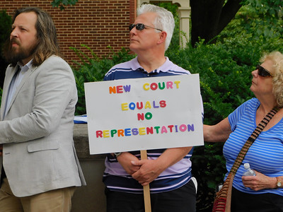 BOB FINNAN / GAZETTE There were about 35-40 people at the courthouse rally Thursday. Daniel Maynard, left, is the bailiff for the Medina County Domestic Relations Court.