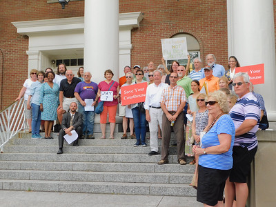 BOB FINNAN / GAZETTE Attendees of an information rally at the courthouse Thursday pose for a picture afterward on the courthouse steps in Medina. There were about 35-40 people at the rally.