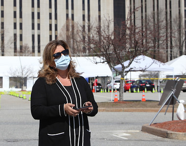 CVS division vice president Alisa Ulrey speaks to a Sun reporter as the City of Lowell, MEMA and CVS run a COVID-19 rapid testing center in the parking lot of Showcase Cinema near Cross Point Towers. (SUN/Julia Malakie)