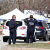Lowell Police watch one of the lines as the City of Lowell, MEMA and CVS run a COVID-19 rapid testing center in the parking lot of Showcase Cinema near Cross Point Towers. (SUN/Julia Malakie)