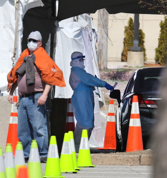 City of Lowell, MEMA and CVS run a COVID-19 rapid testing center in the parking lot of Showcase Cinema near Cross Point Towers. People did their own swabbing in their car and handed back the swab. (SUN/Julia Malakie)