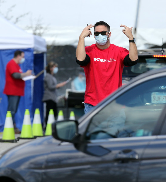 City of Lowell, MEMA and CVS run a COVID-19 rapid testing center in the parking lot of Showcase Cinema near Cross Point Towers. (SUN/Julia Malakie)