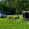 KRISTOPHER RADDER — BRATTLEBORO REFORMER<br /> A UMass Memorial LifeFlight was called to airlift a patient with injuries after a motor vehicle and a motorcycle crashed on Route 112, in Halifax on Tuesday, Aug. 20, 2019.  The crash is under investigation by Vermont State Police. Stone Field near Larrabee Road was turned into a landing zone.