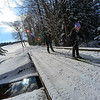 KRISTOPHER RADDER - BRATTLEBORO REFORMER<br /> Donna Smyth, of Vernon, and Hank Lange, of Brattleboro,cross over a bridge while cross-country skiing at the Brattleboro Country Club.