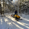 KRISTOPHER RADDER - BRATTLEBORO REFORMER<br /> Mark Eggert, primary groomer, uses a snowmobile with a special attachment to groom cross-country trails at the Brattleboro Country Club on Thursday, Jan. 18, 2018. The trails are maintained by the Brattleboro Outing Club.