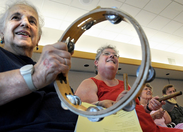"Jean Gore, of Boulder, left, and her daughter Mim Campos, also of Boulder, center, play latin instruments while participating in a latin guitar performance during Cuba Day on Saturday, July 23, at the Senior Center in the East Boulder Recreation Center on Sioux Drive in Boulder. For more photos and video of Cuba Day go to  <a href=""http://www.dailycamera.com"">http://www.dailycamera.com</a><br /> Jeremy Papasso/ Camera"
