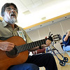 "Denys Vigil, of Lafayette, left, plays some latin guitar music during Cuba Day on Saturday, July 23, at the Senior Center in the East Boulder Recreation Center on Sioux Drive in Boulder. For more photos and video of Cuba Day go to  <a href=""http://www.dailycamera.com"">http://www.dailycamera.com</a><br /> Jeremy Papasso/ Camera"