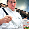 Becky Steere whisks a vinaigrette during her farm to table cooking class at the Culinary School of the Rockies in Boulder on Thursday, July 15.<br /> Greg Lindstrom / The Camera