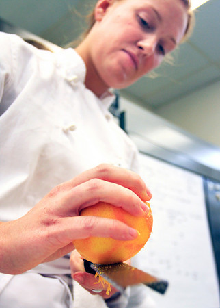 Lauren Limberd grates an orange zest during her farm to table cooking class at the Culinary School of the Rockies in Boulder on Thursday, July 15.<br /> Greg Lindstrom / The Camera