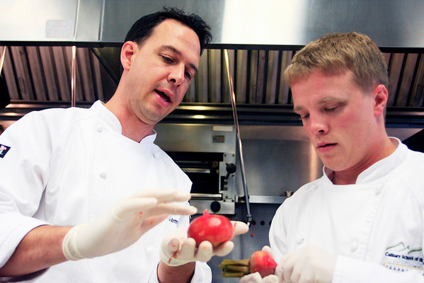 Chef Chad Armstrong (left) instructs Aaron Shute on how to peel beets during the farm to table cooking class at the Culinary School of the Rockies in Boulder on Thursday, July 15.<br /> Greg Lindstrom / The Camera