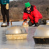 KRISTOPHER RADDER — BRATTLEBORO REFORMER<br /> A group of people from around the Northeast and the Netherlands play a game of curling with makeshift hammers that were made from pans, concrete, and rebar on Wednesday, Jan. 2, 2019.