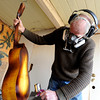"""Jonas Ceelen, of Boulder, sprays a mixture of stain and polyurethane onto a custom acoustic guitar on Friday, Jan. 26, at the Jonas Guitar shop on Arapahoe Avenue in Boulder. For a video interview about the custom guitar building go to  <a href=""""http://www.dailycamera.com"""">http://www.dailycamera.com</a><br />  Jeremy Papasso/ Camera"""