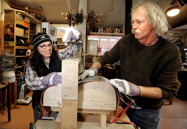"Jan Higa, of Boulder, left, and Jonas Ceelen, also of Boulder, work together to build a custom guitar on Thursday, Jan. 26, at the Jonas Guitar shop in Boulder, For a video of the guitar building process go to  <a href=""http://www.dailycamera.com"">http://www.dailycamera.com</a><br /> Jeremy Papasso/ Camera"