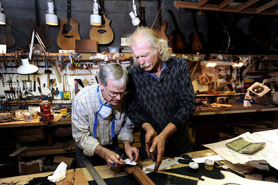 Terry Kenyon, left, and Jonas Ceelen, both of Boulder, work together to build a custom guitar on Tuesday, Jan. 24, at the Jonas Guitar shop at 7648 Arapahoe Rd. in Boulder. For a video of the guitar building process go to www.dailycamera.com  Jeremy Papasso/ Camera