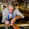 "Terry Kenyon, of Boulder, works to design the head stock of his custom guitar on Tuesday, Jan. 24, at the Jonas Guitar shop at 7648 Arapahoe Rd. in Boulder. For a video of the guitar building process go to  <a href=""http://www.dailycamera.com"">http://www.dailycamera.com</a><br />  Jeremy Papasso/ Camera"