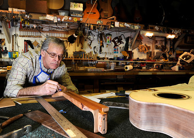 Terry Kenyon, of Boulder, works on his custom guitar on Tuesday, Jan. 24, at the Jonas Guitar shop at 7648 Arapahoe Rd. in Boulder. For a video of the guitar building process go to www.dailycamera.com  Jeremy Papasso/ Camera