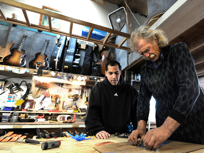 Stuart Brooks, 23, of Boulder, left, works with Jonas Ceelen to make a custom guitar on Tuesday, Jan. 24, at Jonas Guitar shop at 7648 Arapahoe Rd. in Boulder. For a video of the guitar building process go to www.dailycamera.com  Jeremy Papasso/ Camera