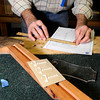 """Terry Kenyon, of Boulder, takes measurements while building his own custom guitar on Tuesday, Jan. 24, at the Jonas Guitar shop at 7648 Arapahoe Rd. in Boulder. For a video of the guitar building process go to  <a href=""""http://www.dailycamera.com"""">http://www.dailycamera.com</a><br />  Jeremy Papasso/ Camera"""