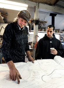 Jonas Ceelen, of Boulder, left, and Stuart Brooks, also of Boulder, look at a blueprint for a custom guitar on Tuesday, Jan. 24, at Jonas Guitar shop at 7648 Arapahoe Rd. in Boulder. For a video of the guitar building process go to www.dailycamera.com  Jeremy Papasso/ Camera