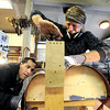 "Stuart Brooks, 23, of Boulder, left, watches as Jonas Ceelen works to bend a piece of wood while building a custom guitar on Tuesday, Jan. 24, at Jonas Guitar shop at 7648 Arapahoe Rd. in Boulder. For a video of the guitar building process go to  <a href=""http://www.dailycamera.com"">http://www.dailycamera.com</a><br />  Jeremy Papasso/ Camera"