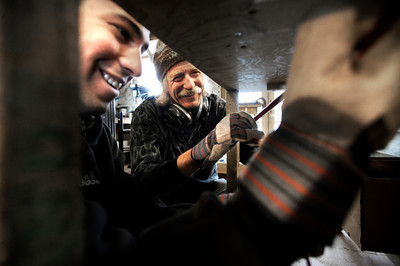 Stuart Brooks, 23, of Boulder, left, laughs as he works with Jonas Ceelen to build a custom guitar on Tuesday, Jan. 24, at Jonas Guitar shop at 7648 Arapahoe Rd. in Boulder. For a video of the guitar building process go to www.dailycamera.com  Jeremy Papasso/ Camera