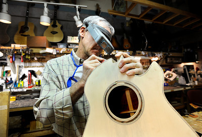 Terry Kenyon, of Boulder, works to make a custom steel string acoustic guitar on Tuesday, Jan. 24, at the Jonas Guitar shop at 7648 Arapahoe Rd. in Boulder. For a video of the guitar building process go to www.dailycamera.com  Jeremy Papasso/ Camera