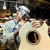 "Terry Kenyon, of Boulder, works to make a custom steel string acoustic guitar on Tuesday, Jan. 24, at the Jonas Guitar shop at 7648 Arapahoe Rd. in Boulder. For a video of the guitar building process go to  <a href=""http://www.dailycamera.com"">http://www.dailycamera.com</a><br />  Jeremy Papasso/ Camera"