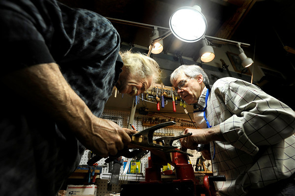 """Jonas Ceelen, left, and Terry Kenyon, both of Boulder, work together to design the neck of a custom guitar on Tuesday, Jan. 24, at the Jonas Guitar shop at 7648 Arapahoe Rd. in Boulder. For a video of the guitar building process go to  <a href=""""http://www.dailycamera.com"""">http://www.dailycamera.com</a><br />  Jeremy Papasso/ Camera"""