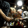 "Jonas Ceelen, left, and Terry Kenyon, both of Boulder, work together to design the neck of a custom guitar on Tuesday, Jan. 24, at the Jonas Guitar shop at 7648 Arapahoe Rd. in Boulder. For a video of the guitar building process go to  <a href=""http://www.dailycamera.com"">http://www.dailycamera.com</a><br />  Jeremy Papasso/ Camera"