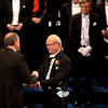 The 2012 Nobel Prize Laureate for Physics David J. Wineland from the U.S. receives his Nobel Prize from Sweden's King Carl XVI Gustaf, right, during the Nobel Prize award ceremony at the Stockholm Concert Hall in Stockholm, Monday, Dec. 10, 2012. The Nobel awards are always awarded on Dec. 10, the anniversary of Alfred Nobel's death in 1896. The prizes for laureates in medicine, chemistry, physics and literature are awarded in the Swedish capital Stockholm, whilst the Nobel Peace Prize is awarded on the same day in Oslo, Norway. (AP Photo/Matt Dunham)