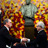The 2012 Nobel Prize Laureate for Physics Dr David J. Wineland, left, of US receives his Nobel Prize from Sweden's King Carl XVI Gustaf during the Nobel Prize award ceremony at the Stockholm Concert Hall in Stockholm, Sweden on  Monday Dec. 10, 2012.   (AP Photo/Scanpix Sweden/Henrik Montgomery, Pool)