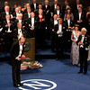 The 2012 Nobel Prize Laureate for Physics David J. Wineland, center, from the U.S. bows after receiving his Nobel Prize from Sweden's King Carl XVI Gustaf, at right, during the Nobel Prize award ceremony at the Stockholm Concert Hall in Stockholm, Monday, Dec. 10, 2012. The Nobel awards are always awarded on Dec. 10, the anniversary of Alfred Nobel's death in 1896. The prizes for laureates in medicine, chemistry, physics and literature are awarded in the Swedish capital Stockholm, whilst the Nobel Peace Prize is awarded on the same day in Oslo, Norway. (AP Photo/Matt Dunham)