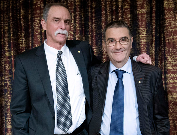 Nobel Laureates  in Physics for  2012,  David Wineland, left, from the US and Serge Haroche of France pose for photographers, during a news conference, in Stockholm, Sweden, Friday, Dec. 7, 2012. (AP Photo/Bertil Enevag Ericson) SWEDEN OUT