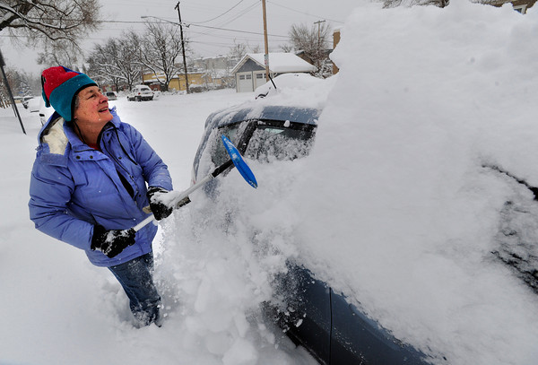 Emmorette Strand digs out her car in Boulder Colo.  on Thursday morning. She was on her way to her dog walking job at the Humane Society of Boulder Valley. December 22, 2011<br /> Photo by Paul Aiken