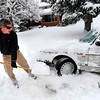 Chris Wirth works to dig his car out on University Hill in Boulder. He was on the way to his puzzle company which is in the midst of the holiday rush. December 22, 2011<br /> Photo by Paul Aiken